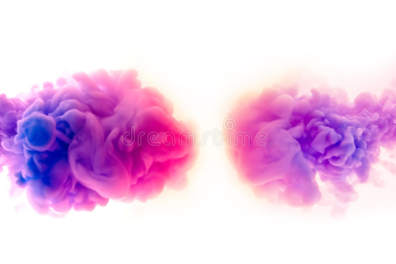 Paint pigment clouds. Black Light paint pigment clouds floating in water on white background stock photo