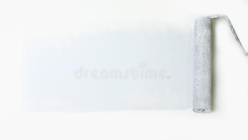 Paint roller on the background of white walls. photo with copy space stock photos