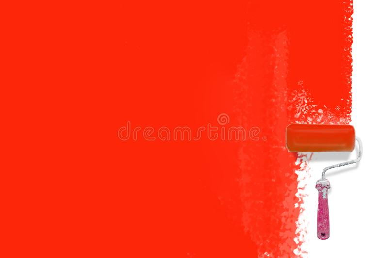 Paint roller brush  painting red backgrounbd - Creative renovation concept royalty free stock images