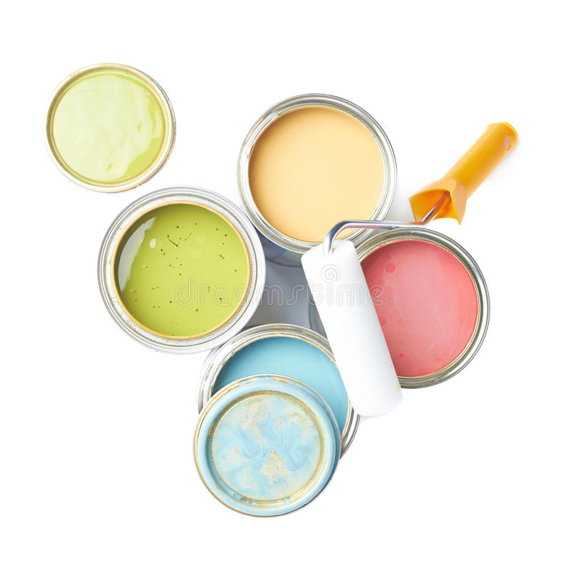 Paint roller over cans of paint stock photos