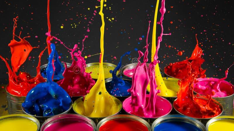 Paint Splash Tins. Paint Splash of colourful paint stock photos