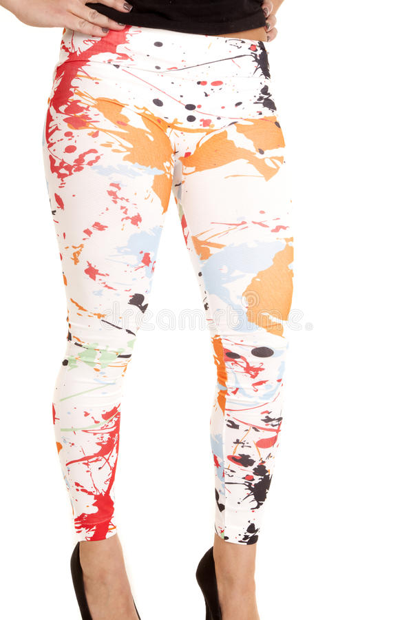 Paint splat leggings. A woman in her white paint splat leggings standing royalty free stock images