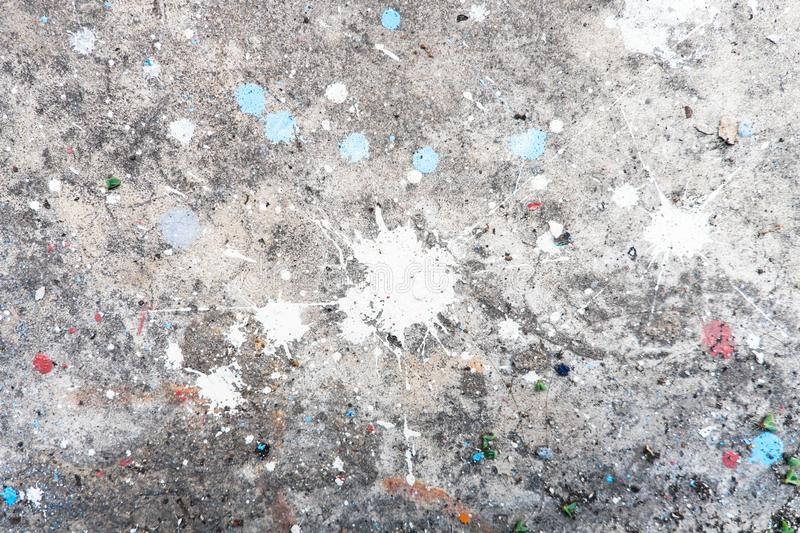 Paint splat white and blue color. Dropped on concrete floor royalty free stock image