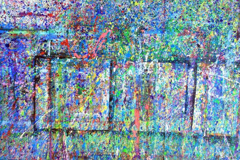 Paint splatter. Ed wall in an art studio stock photo