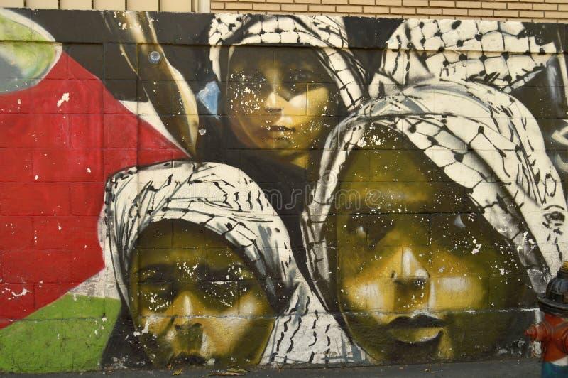 Venezuelan urban art, Maracay. Paint on a street wall in Maracay city, Venezuela. South america. Face of children looking you stock image