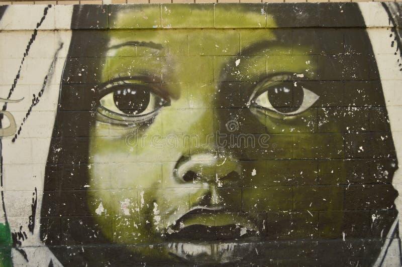 Venezuelan urban art, Maracay. Paint on a street wall in Maracay city, Venezuela. South america. Face of children looking you royalty free stock images