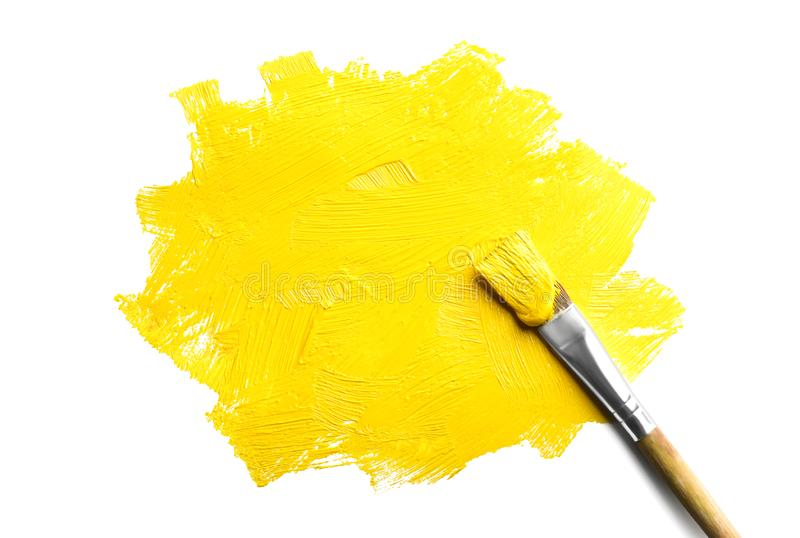 Paint stroke and brush on white background stock images