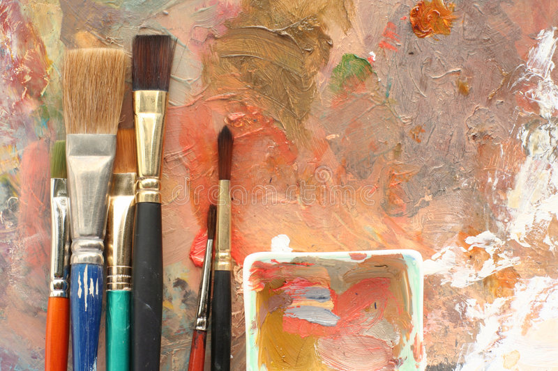 Paint studio; palettes & brushes royalty free stock images