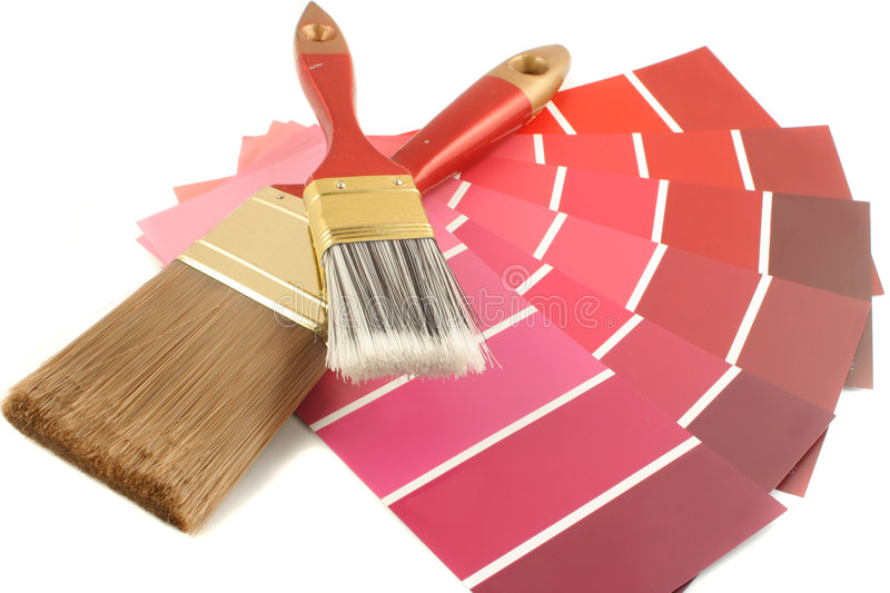 Paint swatches. Red shade paint swatches, and small roller brush for home decorating royalty free stock photo