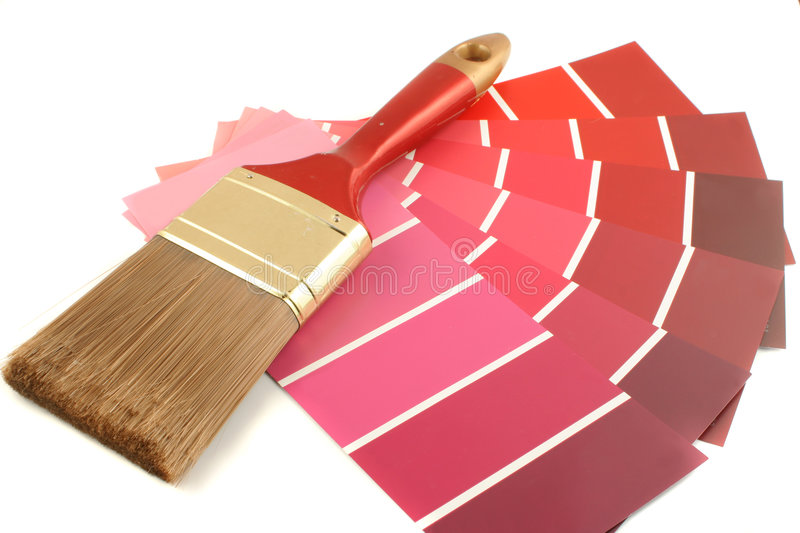 Paint swatches. Red shade paint swatches, and small roller brush for home decorating royalty free stock images