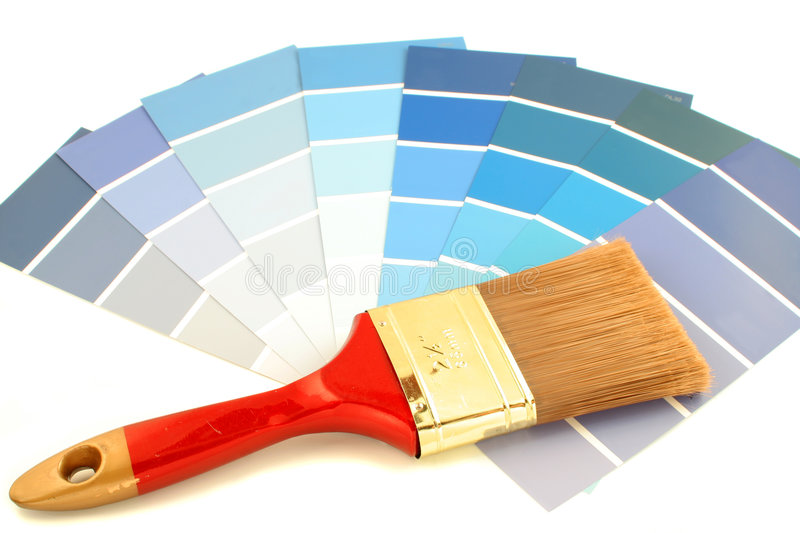 Paint swatches. Blue shade paint swatches, and small paint roller for home decorating stock image