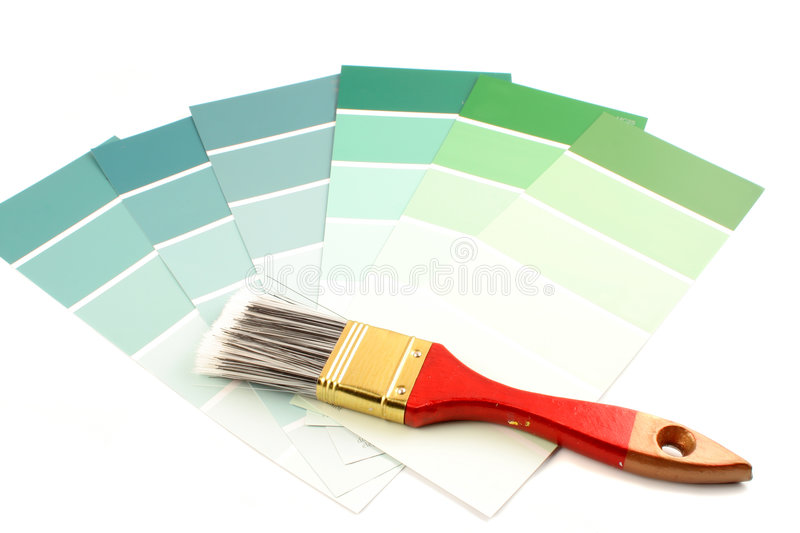 Paint swatches. Green shade paint swatches, and small paint roller for home decorating royalty free stock images