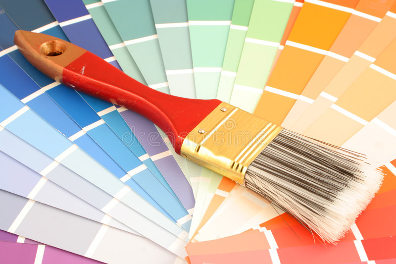 Paint swatches. Rainbow paint swatches, and small paint roller for home decorating stock images