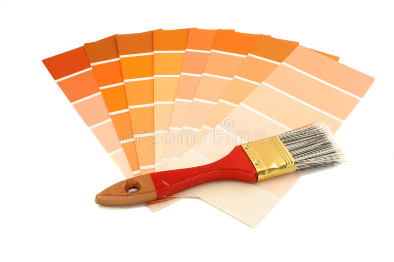 Paint swatches. Rusty and orange shade paint swatches, and small brush for home decorating royalty free stock images