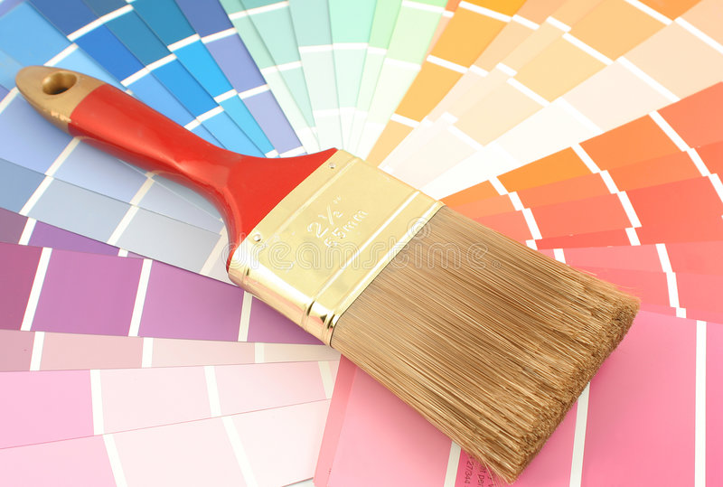 Paint swatches. Rainbow paint swatches, and small paint roller for home decorating stock photo
