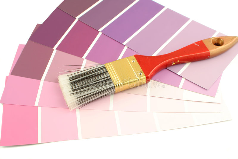 Paint swatches. Purple shades paint swatches, and small paintbrushr for home decorating stock photography
