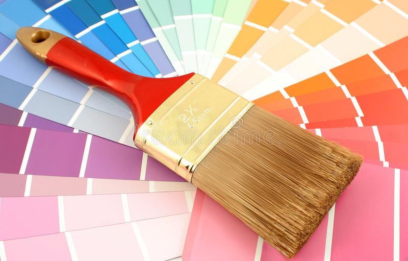 Paint swatches. Rainbow paint swatches, and small paint brush for home decorating royalty free stock photography
