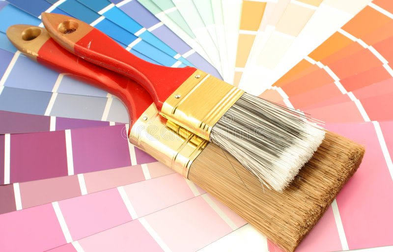 Paint swatches. Rainbow paint swatches, and paint brushes for home decorating stock images