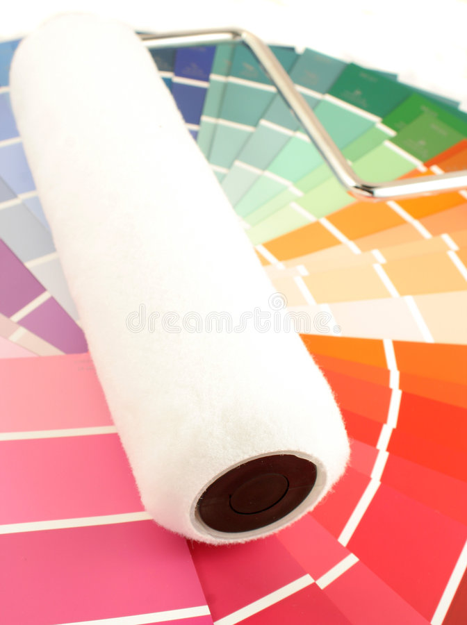 Paint swatches. Rainbow paint swatches, and paint roller for home decorating stock photo