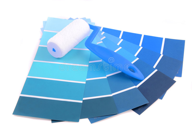 Paint swatches. Blue shade paint swatches, and small roller brush for home decorating stock photography