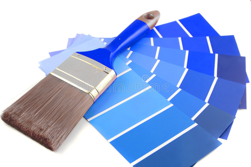 Paint swatches. Blue shade paint swatches, and small roller brush for home decorating stock images