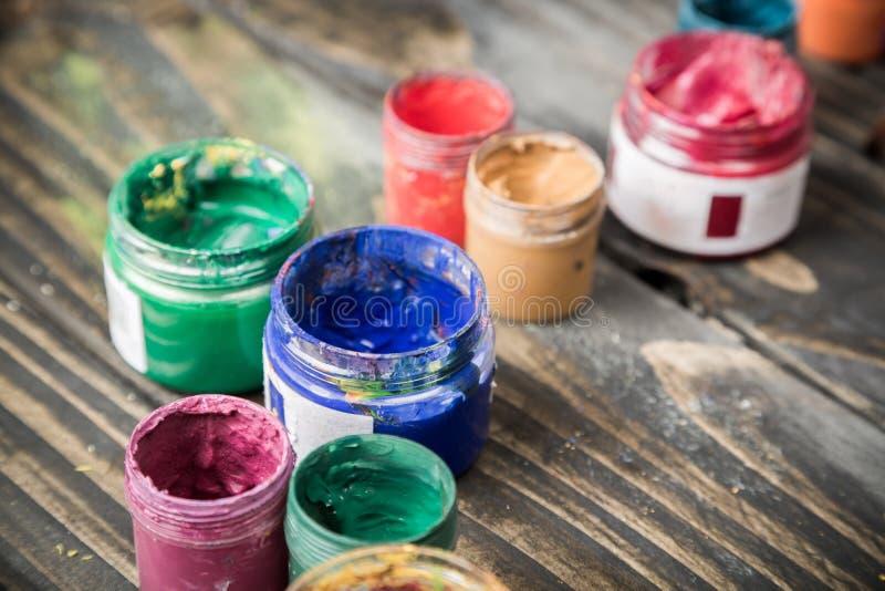 Paint tubes. Brush tubes acrylic vibrant green white stock photography