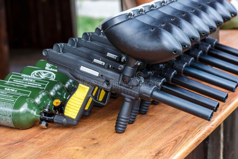 Paintball guns on the table. paintball games can be played on indoor or outdoor fields. Of varying sizes royalty free stock image