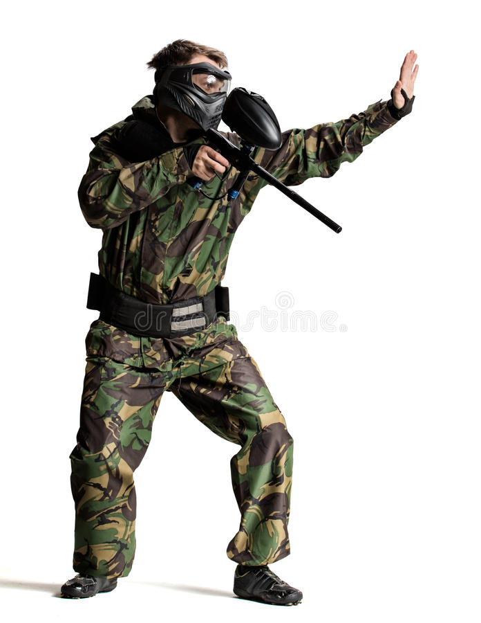 Paintball player in action isolated royalty free stock photo