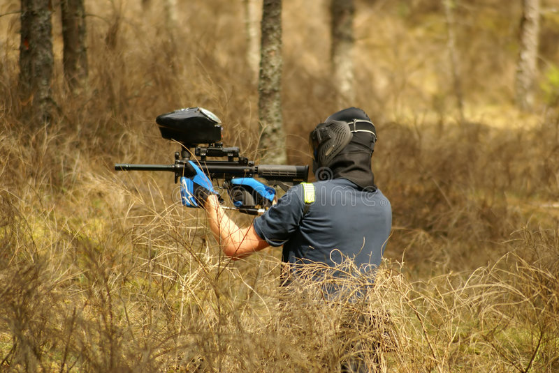 Paintball player in forest stock image