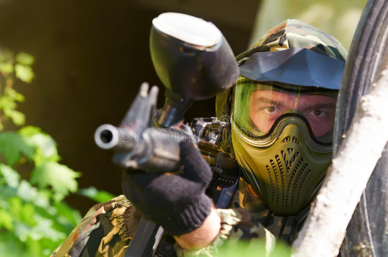 Paintball player with gun royalty free stock photo