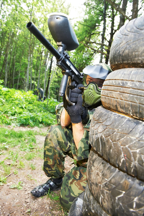 Paintball player holding position