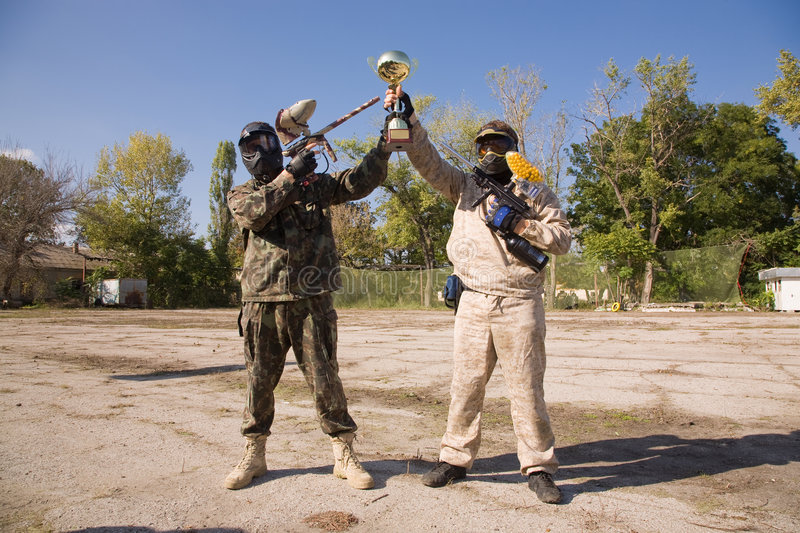 Paintball Players With Gold Cup Royalty Free Stock Photo