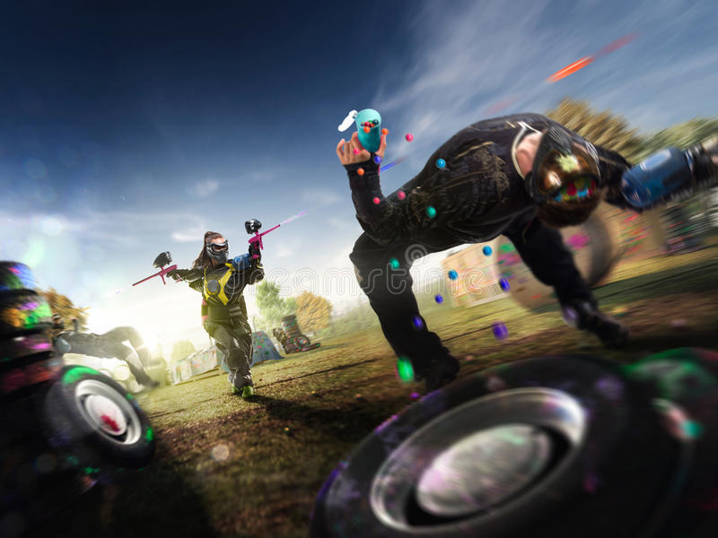 Paintball players are playing the game stock image