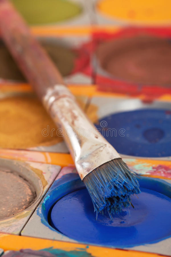 Paintbox with brush stock photography