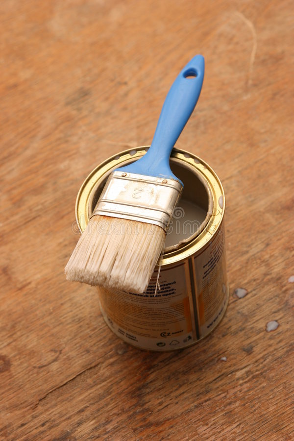 Paintbrush on a can royalty free stock photos