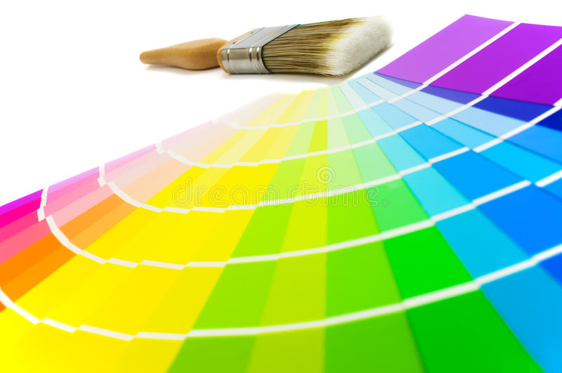 Paintbrush With Color Swatches. Colour swatches with paint brush - focus on brush at rear stock image