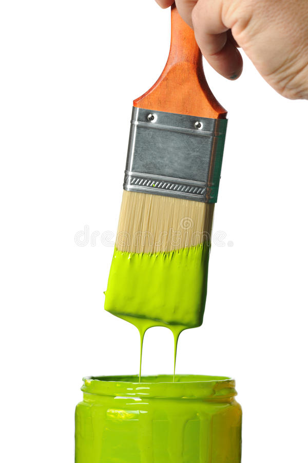 Paintbrush With Green Paint Dripping. Into container isolated over white background royalty free stock photos