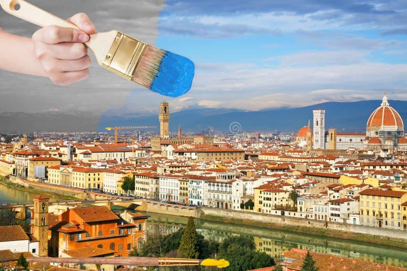 Paintbrush maluje niebieskie niebo nad Florencja miastem fotografia royalty free
