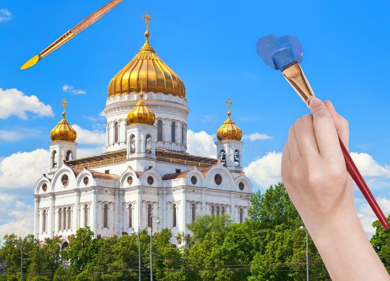Paintbrush maluje niebieskie niebo nad rosyjską katedrą fotografia stock