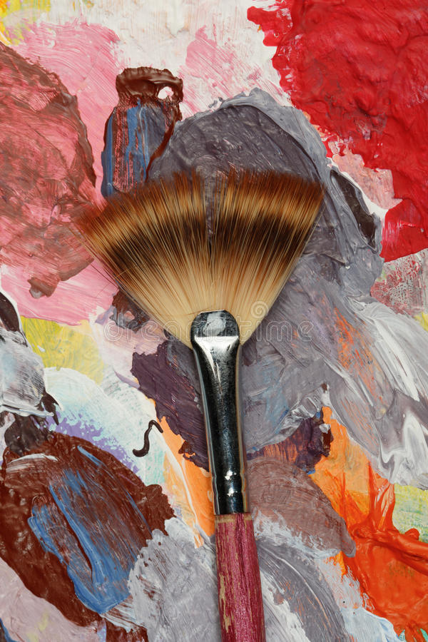 Paintbrush with oil paint royalty free stock photography