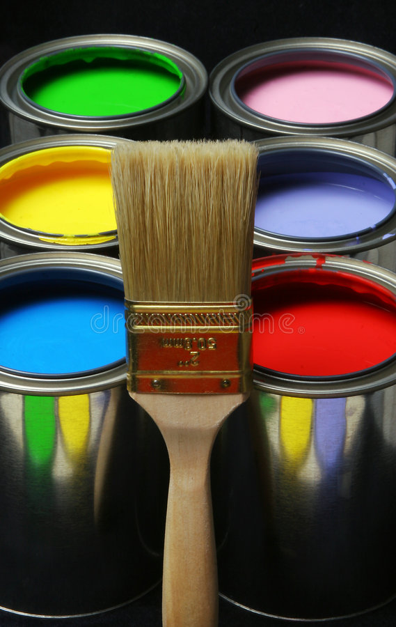 Paintbrush and Paint, Cans of Primary Colored Paints on Black Ba royalty free stock photography