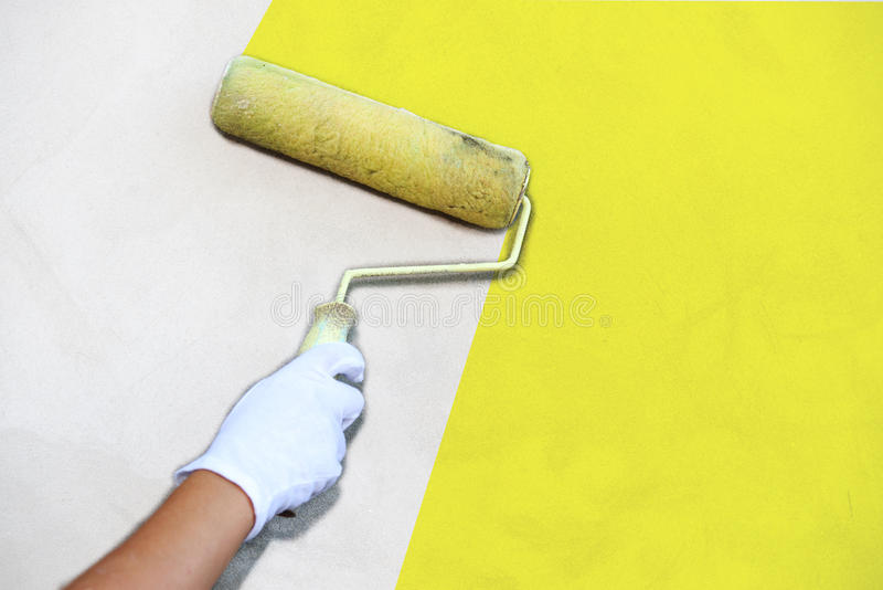 Paintbrush paint the wall. Worker hand with paintbrush paint the wall royalty free stock images