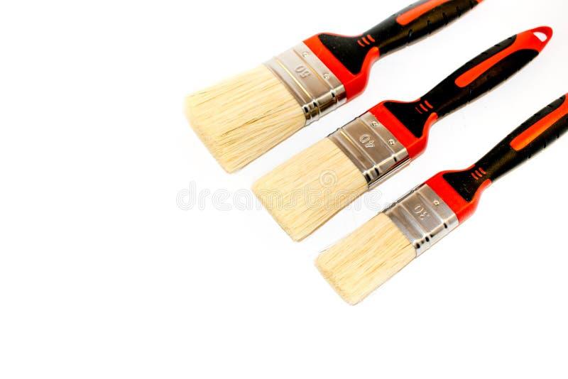 3 paintbrushes изолированного на белой предпосылке стоковые фото