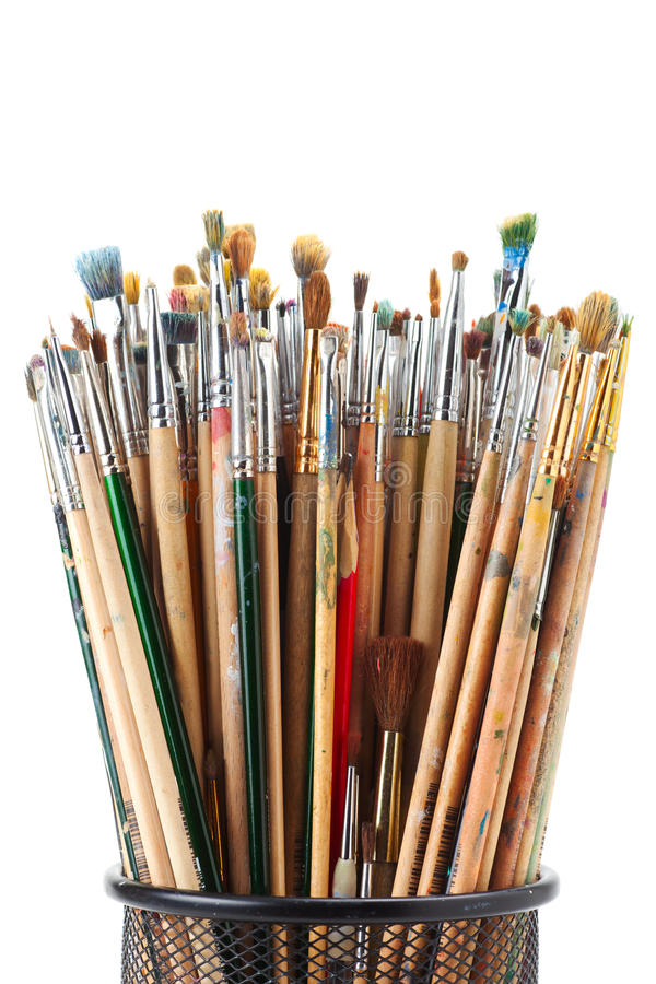 Paintbrushes in black holder cup. On white royalty free stock images