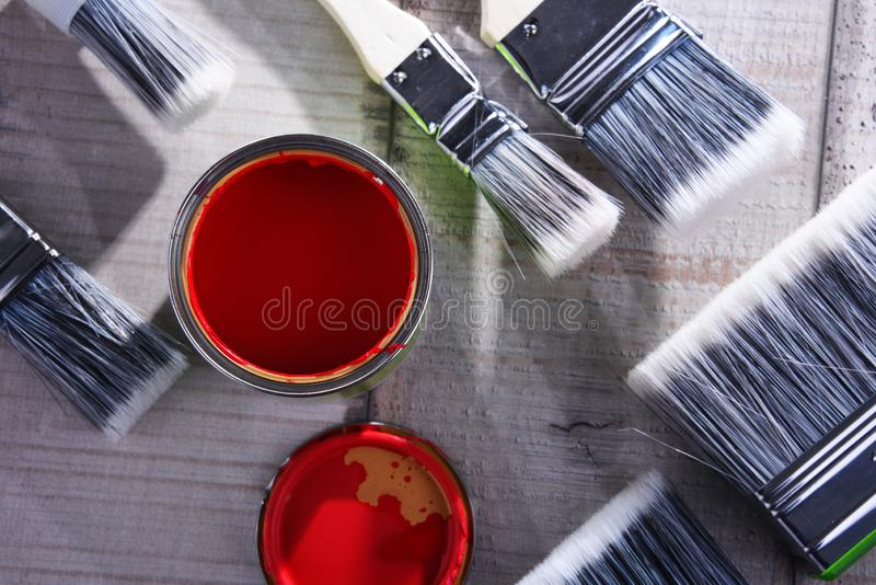 Paintbrushes of different size and paint can stock image