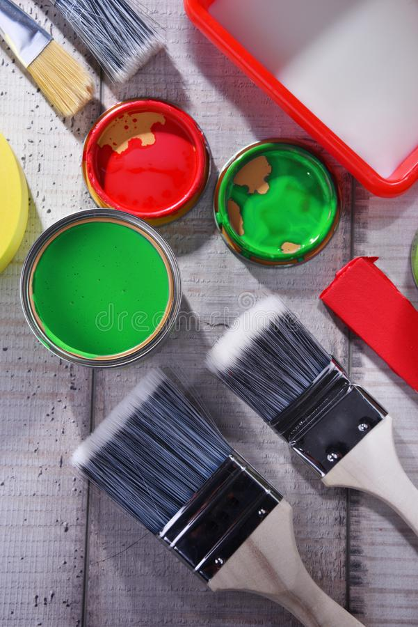 Paintbrushes of different size and paint can stock photos