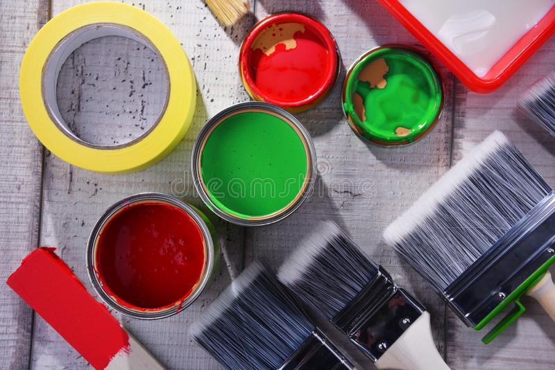 Paintbrushes of different size and paint can royalty free stock images