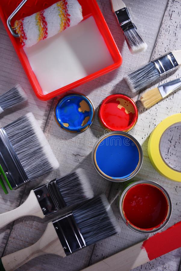 Paintbrushes of different size and paint can royalty free stock photography