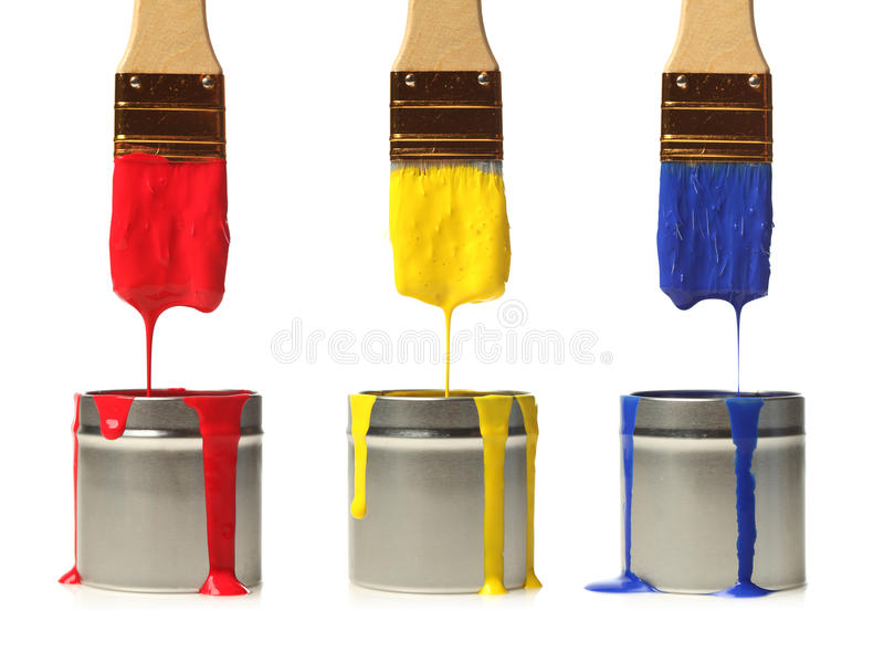 Paintbrushes dripping with paint royalty free stock photography