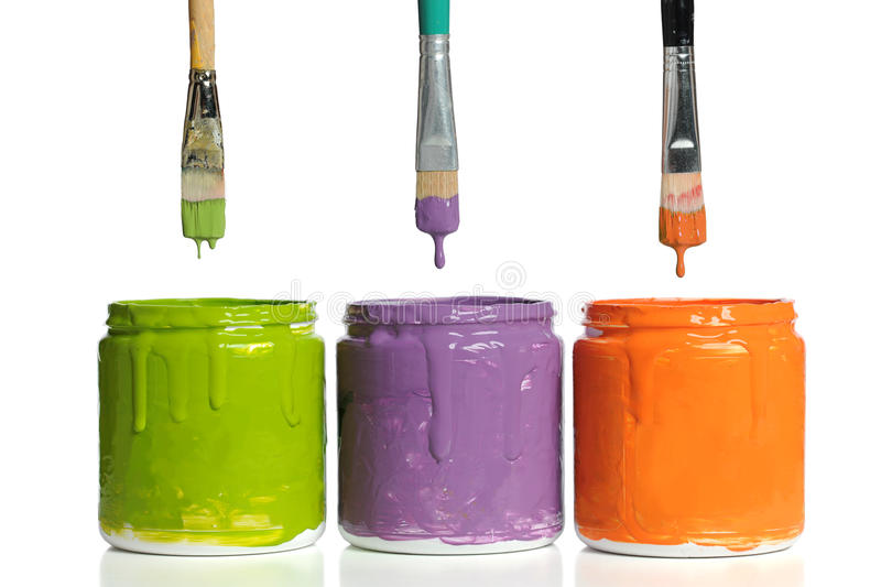 Paintbrushes Dripping Paint into Containers stock image